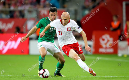 Stock Picture of Poland vs Republic of Ireland. Ireland's Enda Stevens with Rafal Kurzawa of Poland