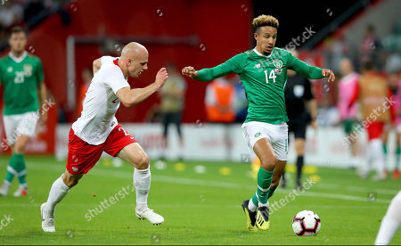 Poland vs Republic of Ireland. Ireland's Callum Robinson with Rafal Kurzawa of Poland