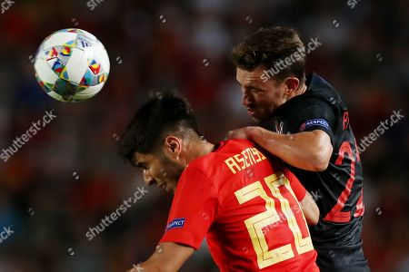 Marco Asensio of Spain and Josip Pivaric of Croatia