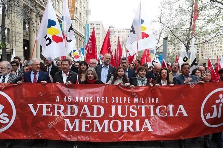 Members of the Party for Democracy and the Socialist Party, including the Presidents of both formations, Heraldo Munoz (2L) and Alvaro Elizalde (C) respectively, participate in a march in homage to the late President Salvador Allende (1970-1973), around the Palace of La Moneda, Santiago, Chile, 11 September 2018. On 11 September 1973, Chilean socialist president Salvador Allende was overthrown by the armed forces and police.