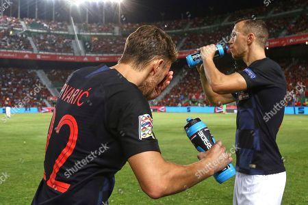 Josip Pivaric and Ivan Perisic of Croatia drinking water before the kick off