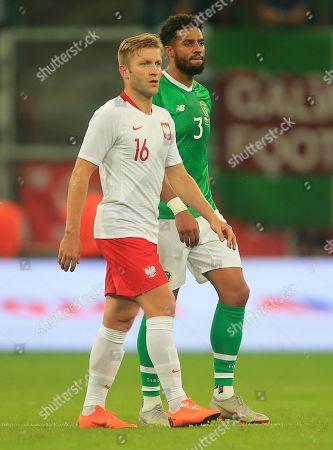 Cyrus Christie of Republic of Ireland and Jakub Blaszczykowski of Poland