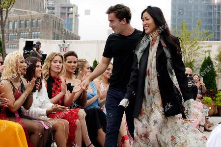 Nicki Minaj, Fernando Garcia, Laura Kim. Co-Creative Directors of Oscar de la Renta, Fernando Garcia and Laura Kim, acknowledge audience applause, including Nicki Minaj, left, after their spring 2019 collection was modeled during Fashion Week in New York