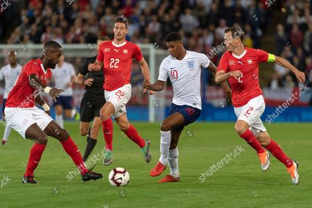Stock Image of Switzerland's Johan Djourou, England's Marcus Rashford and Switzerland's Stephan Lichtsteiner, from left, fight for the ball during the friendly soccer match between England and Switzerland at the King Power Stadium in Leicester, England, on Tuesday, September 11, 2018.