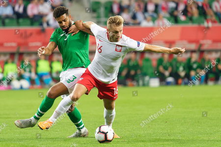 Poland's Jakub Blaszczykowski (R) and Cyrus Christie (L) from Ireland in action during the International Friendly soccer match between Poland and Ireland in Wroclaw, Poland,  11 September 2018.