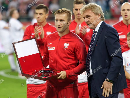 Polish national team player Jakub Blaszczykowski (L) with a commemorative platter received from the chairman of Polish Football Association Zbigniew Boniek (R) on the occasion of joining the group of players who played at least 100 matches in the national team. The ceremony took place before the friendly match Poland - Ireland, 11 September in Wroclaw, Poland,  11 September 2018.