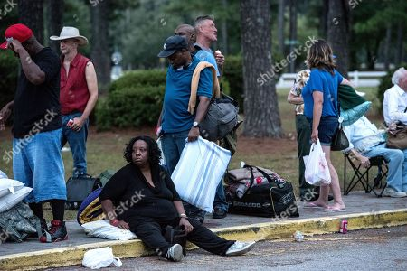 People evacuate ahead of the forecasted landfall of Hurricane Florence as they seek shelter at Emma B. Trask Middle School in Wilmington, North Carolina, USA, 11 September 2018. The category four storm could be the strongest to strike the Carolina coast since Hurricane Hugo in 1989.