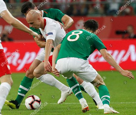 Stock Photo of Rafal Kurzawa, Callum O'Dowda. Poland's Rafal Kurzawa, center, is challenged by Ireland's Callum O'Dowda, right, during their friendly soccer match between Poland and Ireland at stadium in Wroclaw, Poland