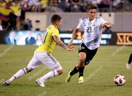 Argentina's Paulo Dybala, right, drives against Colombia's Juan Fernando Quintero during the second half of a international soccer friendly match, in East Rutherford, N.J. The teams tied 0-0