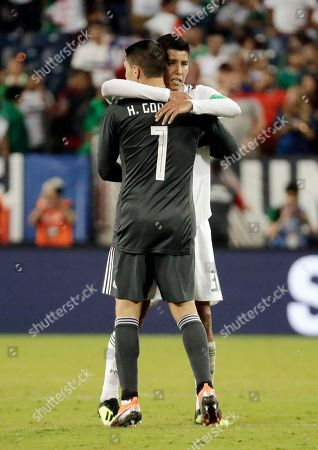 Zack Stefen, Hugo Ayala. U.S. goalkeeper Zack Steffen (1) hugs Mexico defenseman Hugo Ayala after an international friendly match, in Nashville, Tenn. The U.S. won 1-0