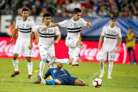 Mexico's midfielder Erick Aguirre (C, top) leaps over USA midfielder Julian Green (bottom) in the second half of their friendly soccer match at Nissan Stadium in Nashville, Tennessee, USA, 11 September 2018.