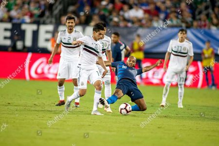 Mexico midfielder Erick Aguirre (C-L) and USA midfielder Julian Green (C-R) go for the ball in the second half of their friendly soccer match at Nissan Stadium in Nashville, Tennessee, USA, 11 September 2018.