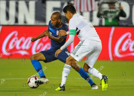 US midfielder, Julian Green (16), and Mexico defender, Hugo Ayala (3), fight for control of the ball, during the International Friendly match between Mexico and USA at Nissan Stadium in Nashville, TN. The US National team defeated Mexico, 1-0