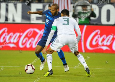US midfielder, Julian Green (16), tries to get the ball past Mexico defenseman, Hugo Ayala (3), during the International Friendly match between Mexico and USA at Nissan Stadium in Nashville, TN. The US National team defeated Mexico, 1-0