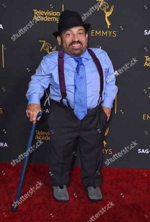 Danny Woodburn arrives at the 2018 Dynamic and Diverse Emmy Nominee Reception presented by the Television Academy, in North Hollywood, Calif