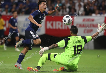 , Osaka, Japan - Japan's Ritsu Doan (L) fights the ball against Costa Rican goalie Leonel Moreira during an international friendly match against Costa Rica, Kirin Challenge Cup in Osaka on Tuesday, September 11, 2018. Japan defeated Costa Rica 3-0.