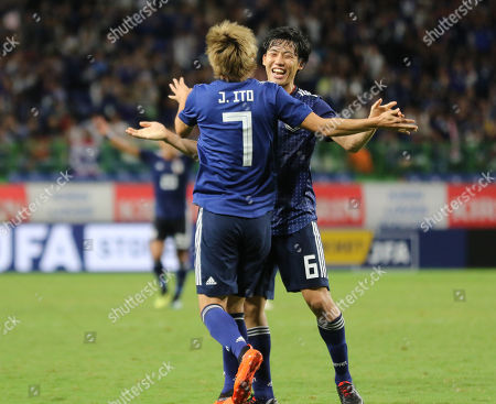, Osaka, Japan - Japan's Junya Ito (L) is celebrated from his teammate Wataru Endo as he scores a goal during an international friendly match against Costa Rica, Kirin Challenge Cup in Osaka on Tuesday, September 11, 2018. Japan defeated Costa Rica 3-0.