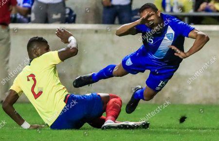 Guatemala's midfielder Jorge Garcia (R) reacts as he falls over Ecuador defender Robert Arboleda (L) in the second half of their friendly soccer match at Toyota Park in Bridgeview, Illinois, USA, 11 September 2018. Ecuador won the match.