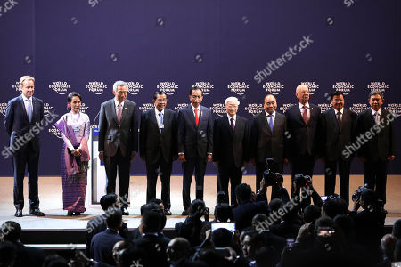 (L-R) Justin Wood, the Head of Regional Strategies and member of the executive committee of the World Economic Forum on Association of Southeast Asian Nations (ASEAN), Myanmar State Counsellor Aung San Suu Kyi, Singapore's Prime Minister Lee Hsien Loong, Cambodia's Prime Minister Samdech Techo Hun Sen, Indonesia's President Joko Widodo, Vietnam's General Secretary Nguyen Phu Truong, Vietnam's Prime Minister Nguyen Xuan Phuc, Founder and Executive Chairman of the World Economic Forum Klaus Schwab, Laos Prime Minister Thongloun Sisoulith, Air Chief Marshal Prajin Juntong, Deputy Prime Minister of Thailand pose for a group photo during the Plenary Session of The World Economic Forum (WEF) on ASEAN, at the National Convention Center in Hanoi, Vietnam, 12 September 2018. The WEF on ASEAN 2018 will be held at the NCC in Hanoi from 11 to 13 September 2018.