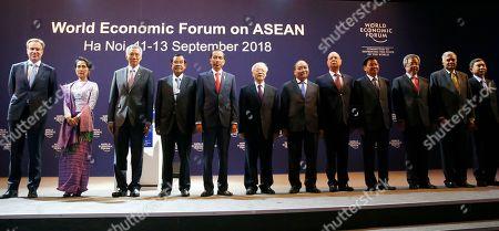 "Justine Wood, Aung San Suu Kyi, Lee Hsien Loong, Hun Sen, Joko ""Jokowi"" Widodo, Nguyen Phu Trong, Nguyen Xuan Phuc of Vietnam, Klaus Schwab, Thongloun Sisoulith, Ranil Wickremesinghe, Hu Chunhua, Prajin Juntong. Klaus Schwab, fifth from right, founder and executive chair of the World Economic Forum poses with invited leaders from Asia during the opening session of the World Economic Forum on ASEAN in Hanoi, Vietnam. From left, Justine Wood of the World Economic Forum, Myanmar leader Aung San Suu Kyi, Singapore Prime Minister Lee Hsien Loong, Cambodian Prime Minister Hun Sen, Indonesian President Joko ""Jokowi"" Widodo, Nguyen Phu Trong, Secretary-General of the Communist Party of Vietnam, Vietnam's Prime Minister Nguyen Xuan Phuc, Schwab, Lao Prime Minister Thongloun Sisoulith, Chinese Vice Premier Hu Chunhua, Sri Lankan Prime Minister Ranil Wickremesinghe and Thailand Justice Minister Prajin Juntong"