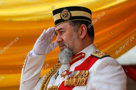 Malaysia's King Sultan Muhammad V salutes during the Trooping of Colours ceremony, in conjunction with his official birthday, in Putrajaya, Malaysia, 12 September 2018. The Trooping of Colours is a demonstration of respect and honor to the king and the country by the Malaysian armed forces.
