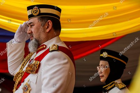 Malaysia's King Sultan Muhammad V (L), with Malaysian Deputy Prime Minister Wan Azizah Wan Ismail, salutes during the Trooping of Colours ceremony, in conjunction with his official birthday, in Putrajaya, Malaysia, 12 September 2018. The Trooping of Colours is a demonstration of respect and honor to the king and the country by the Malaysian armed forces.