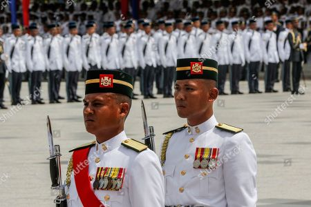 Members of the Malaysian Armed Forces take part in the Trooping of Colours ceremony, in conjunction with Malaysian King Sultan Muhammad V's official birthday, in Putrajaya, Malaysia, 12 September 2018. The Trooping of Colours is a demonstration of respect and honor to the king and the country by the Malaysian armed forces.