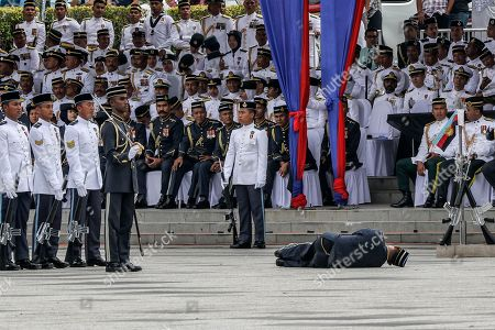 A Malaysian soldier (C) collapses into the floor during the Trooping of Colours ceremony, in conjunction with Malaysian King Sultan Muhammad V's official birthday, in Putrajaya, Malaysia, 12 September 2018. The Trooping of Colours is a demonstration of respect and honor to the king and the country by the Malaysian armed forces.