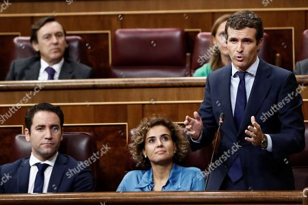 Leader of Spanish People's Party (PP), Pablo Casado (R), delivers a speech next to the party's spokeswoman at Parliament, Dolors Montserrat (2R), during question time at the Lower House in Madrid, Spain, 12 September 2018.