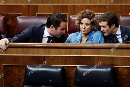 Leader of Spanish People's Party (PP), Pablo Casado (R), chats with the party's spokeswoman at Parliament, Dolors Montserrat (2R), and PP's general secretary, Teodoro Garcia Egea (L), during question time at the Lower House in Madrid, Spain, 12 September 2018.