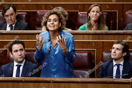 Leader of Spanish People's Party (PP), Pablo Casado (R), and PP's general secretary, Teodoro Garcia Egea (L), listen to the party's spokeswoman at Parliament, Dolors Montserrat (C), during question time at the Lower House in Madrid, Spain, 12 September 2018.
