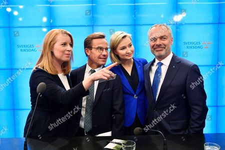 The Swedish 'Alliansen' party leaders (L-R) Annie Loof (Centre), Ulf Kristersson (Moderate), Ebba Busch Thor (Christian Democrats), and Jan Bjorklund (Liberals) pose during a media conference in the Swedish parliment in Stockholm, 12 September 2018. Neither the Swedich centre-left bloc of Social Democrats and Greens nor the centre-right Alliance bloc obtained a majority in the 09 September general elections, with the far-right Sweden Democrats becoming the third largest party.