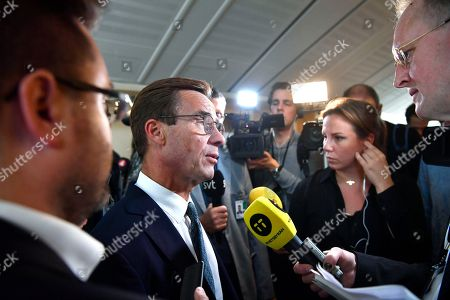 Ulf Kristersson (C-L) of the Moderates is interviewed by journalists as he arrives for a joint media conference with the leaders of the other Swedish 'Alliansen' parties - Ebba Busch Thor of the Christian Democrats, Annie Loof of the Centre and Jan Bjorklund of the Liberals (all unseen) - in Stockholm, 12 September 2018. Neither the Swedich centre-left bloc of Social Democrats and Greens nor the centre-right Alliance bloc obtained a majority in the 09 September general elections, with the far-right Sweden Democrats becoming the third largest party.