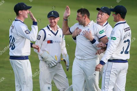 Yorkshire's Tim Bresnan is congratulated on the wicket of Lancashire's Karl Brown.
