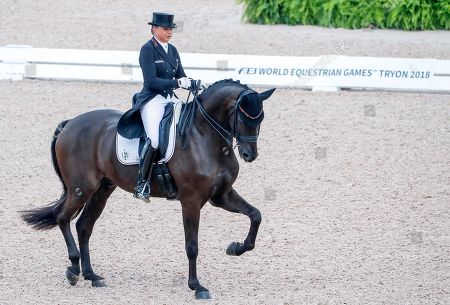 Dorothee Schneider of Germany competes aboard Sammy Davis Jr during the team championship Grand Prix de Dressage at the FEI World Equestrian Games 2018 at the Tryon International Equestrian Center in Mill Spring, North Carolina, USA, 12 September 2018. The World Equestrian Games continue through 23 September 2018.