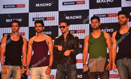 Indian film actor Tiger Shroff seen posing with other models during the launch.