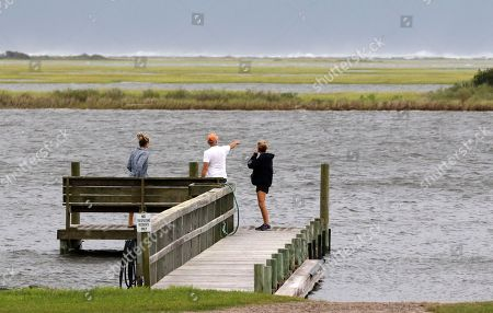 John, Janet, and Caroline Provost watch the waves hit the sand dunes in the distance as Hurricane Florence starts to hit Swansboro N.C