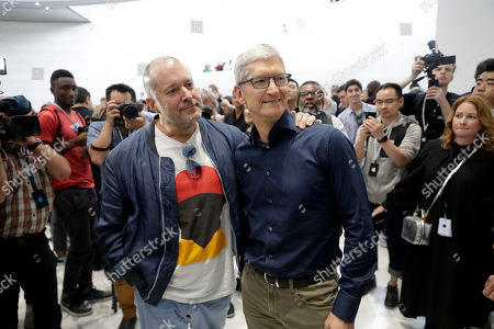 Jonathan Ive, Tim Cook. Jonathan Ive, Apple's chief design officer, left, poses for a photo with CEO Tim Cook during an event to announce new products, in Cupertino, Calif