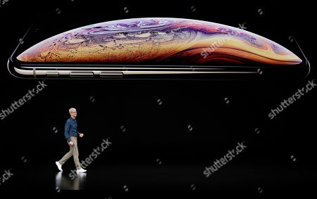 Apple CEO Tim Cook speaks about the Apple iPhone XS at the Steve Jobs Theater during an event to announce new Apple products, in Cupertino, Calif