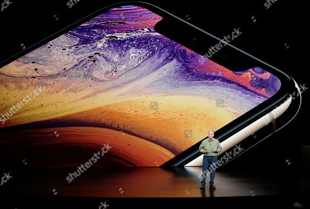 Phil Schiller, Apple's senior vice president of worldwide marketing, speaks about the Apple iPhone XS at the Steve Jobs Theater during an event to announce new Apple products, in Cupertino, Calif
