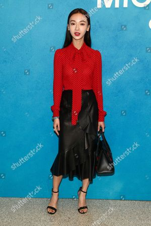 Wu Jinyan attends the NYFW Spring/Summer 2019 Michael Kors fashion show at Pier 17, in New York