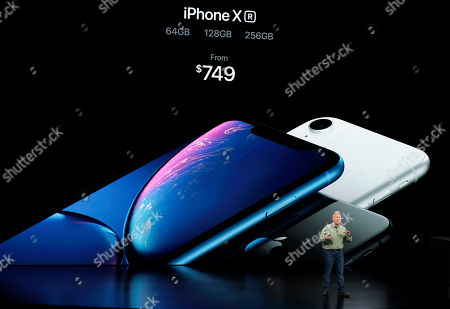 Phil Schiller, Apple's senior vice president of worldwide marketing, speaks about the new Apple iPhone XR at the Steve Jobs Theater during an event to announce new Apple products, in Cupertino, Calif