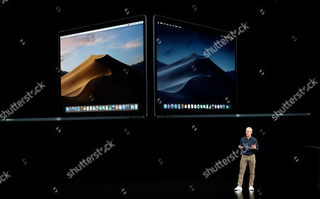 Apple CEO Tim Cook discusses the new MacBook at the Steve Jobs Theater during an event to announce new products, in Cupertino, Calif