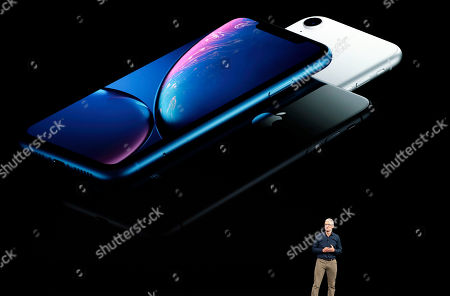 Apple CEO Tim Cook discusses the new iPhones at the Steve Jobs Theater during an event to announce new products, in Cupertino, Calif