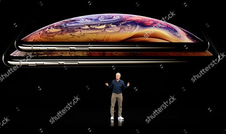 Apple CEO Tim Cook discusses the new iPhone XS and iPhone XS Max at the Steve Jobs Theater during an event to announce new products, in Cupertino, Calif