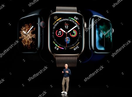Apple CEO Tim Cook discusses the new Apple Watch 4 at the Steve Jobs Theater during an event to announce new products, in Cupertino, Calif
