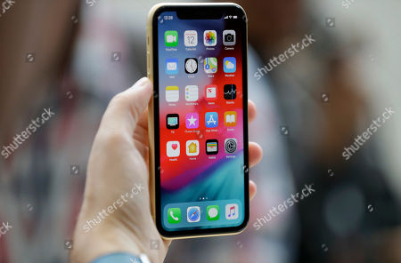 The new Apple iPhone XR is on display at the Steve Jobs Theater after an event to announce new products, in Cupertino, Calif