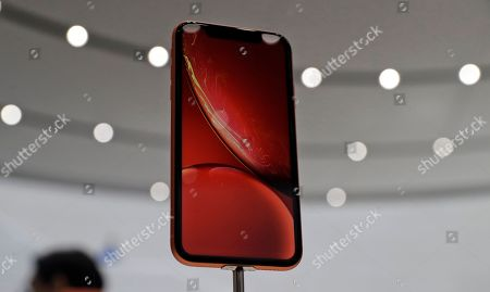 Stock Photo of The new Apple iPhone XR is on display at the Steve Jobs Theater during an event to announce new products, in Cupertino, Calif