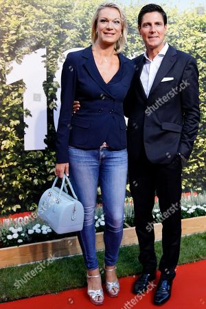 German former akpine ski racer Maria Hoefl-Riesch (L) and her husband Marcus Hoefl (R) attend the 'BILD100 summer party' event in Berlin, Germany, 12 September 2018. 100 of the most important decision-makers from politics and business as well as well-known personalities from sports, art and culture are expected at the event held by Germany's highest-circulation newspaper BILD.