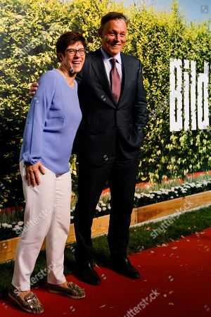Stock Picture of Vice-President of the Bundestag Thomas Oppermann (R) (SPD) and CDU Secretary General Annegret Kramp-Karrenbauer (L) attend the 'BILD100 summer party' event in Berlin, Germany, 12 September 2018. 100 of the most important decision-makers from politics and business as well as well-known personalities from sports, art and culture are expected at the event held by Germany's highest-circulation newspaper BILD.